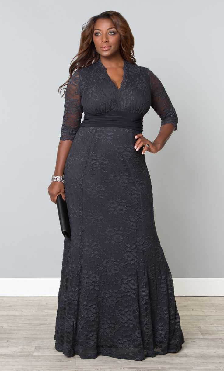 Feel like a million bucks in our plus size Screen Siren Lace Gown.  This elegant fit and flare style is beyond flattering; designed with all-over stretch.  Scalloped sleeves and neckline add a feminine touch while the contrasting waistband draws the eye inward.  #KiyonnaPlusYou  #Plussize  #MadeintheUSA  #Kiyonna