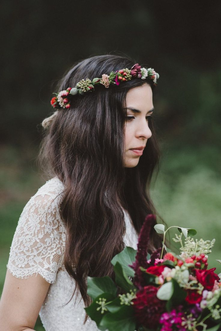bride with berry-toned bouquet and flower crown