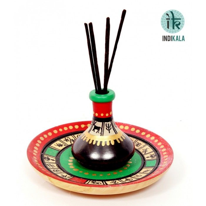 Incense stick holder Warli hand paited incense stick holder is in vibrant colour with a matching plate to collect the ashes of the incense stick. It is artistically designed and a piece of pious beauty. http://www.indikala.com/index.php/featured-products/incense-stick-holder.html