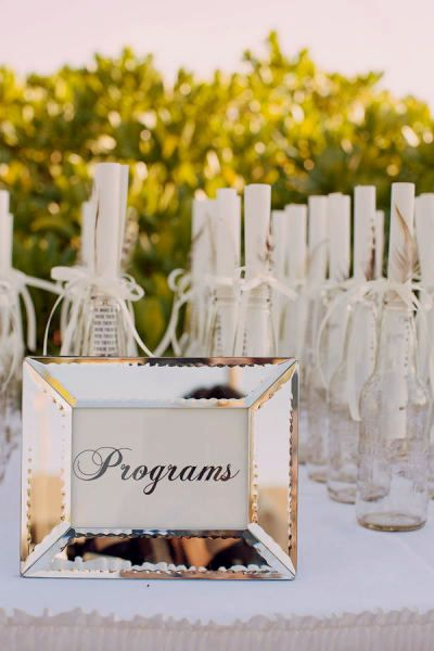These Message-in-a-Bottle Wedding Programs are perfect for a beach wedding. Simply gather a collection of similar bottles and fill it with your rolled-up message. A sweet wedding favor for your guests