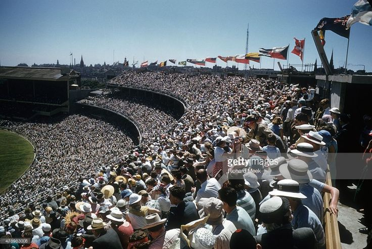 Opening Ceremony, 1956 Summer Olympics. Overview of crowd in stands at Melbourne Cricket Ground Stadium. Melbourne, Australia  Visit page  View image