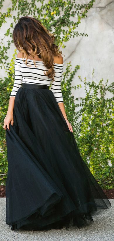 Kim Le is wearing a black maxi tulle skirt from Space 46