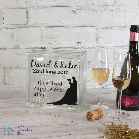 Wedding Silhouette LED Glass Block.  This is gorgeous both as an unusual decoration at your wedding and can then be used in your home. Beautiful glass block filled with LED fairy lights. This is personalised with your name and wedding date so is a stunning memory of the special wedding date.  This is a perfect gift for a wedding, newlywed couple or as a stunning, contemporary anniversary gift.  A way to remember their special day decoratively within the home.