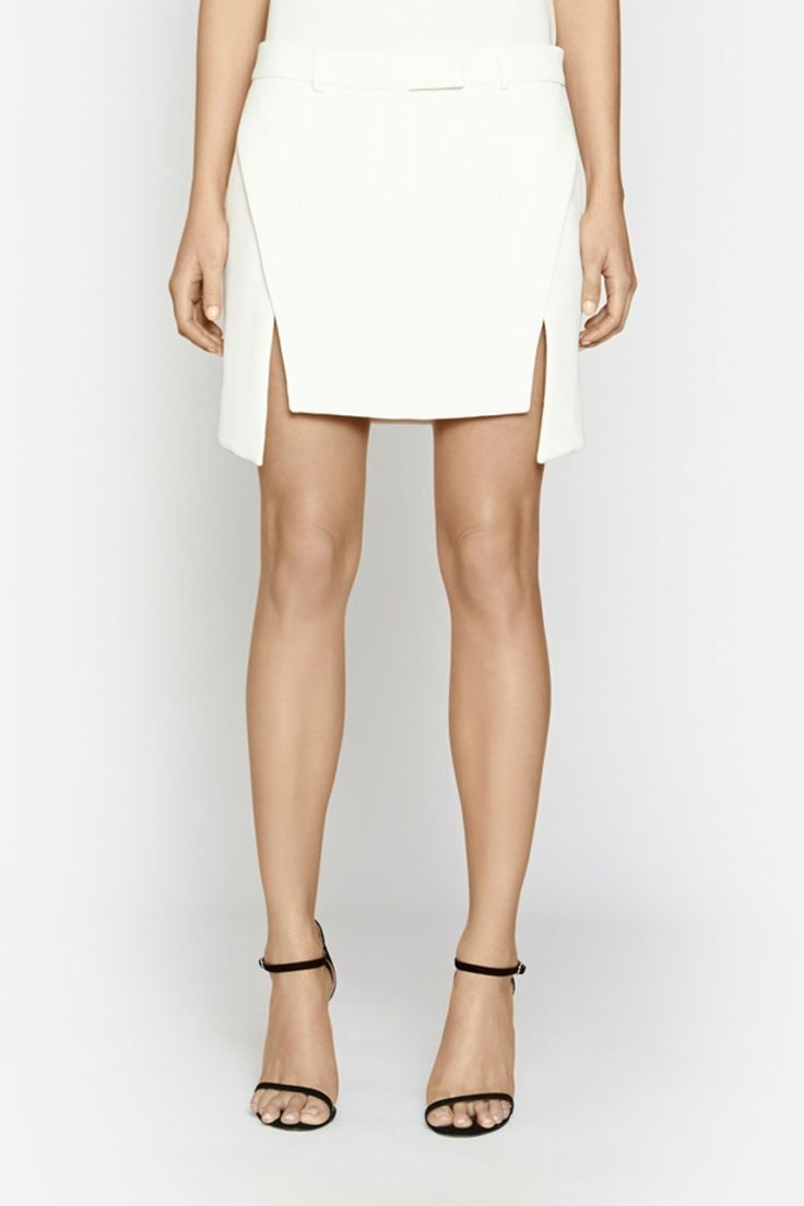 Camilla and Marc | PENTAGON SKIRT  US$273.20 Tailored mini skirt designed in a textured waffle fabric in white. This wardrobe staple is given a modern update with a multi-panel design which created two splits at the front. Also includes a waistband, concealed zipper fastening and belt loops.