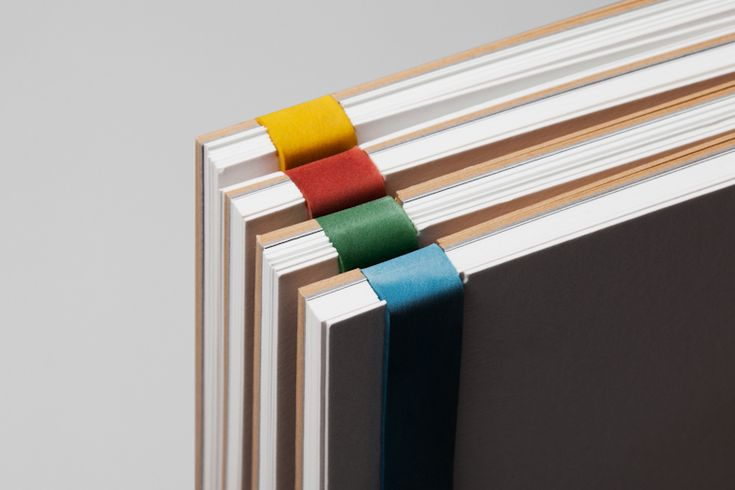 Notebooks with bright rubber band designed by Hey for glassware maker Jeremy Maxwell Wintrebert.
