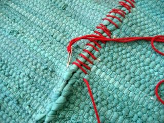 DIY: Make your own rug Buy inexpensive rugs for $3.99 each, a large needle, contrasting cotton yarn, and slip stitch the rugs together to make an area rug,
