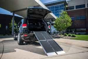 Trifold portable wheelchair ramp