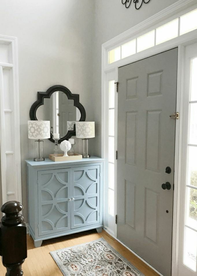 Great grays, soft & airy wall color with contrasting gray door.  Benjamin Moore has some of the most sought after colors.   #grays #interiordecorator #design #interiordesign #designcenter #homeimprovement #nh #shoplocal #exeter #epping #nh #seabrook #benjaminmoore #popular #color #homeowner