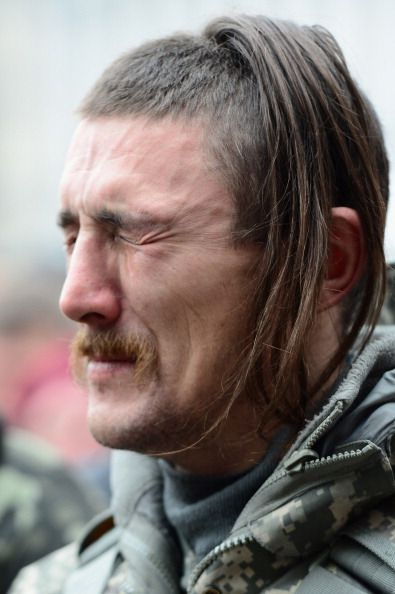 A Cossack in Kyiv, Ukraine attends his friend's funeral in Independence Square. 22-2-2014