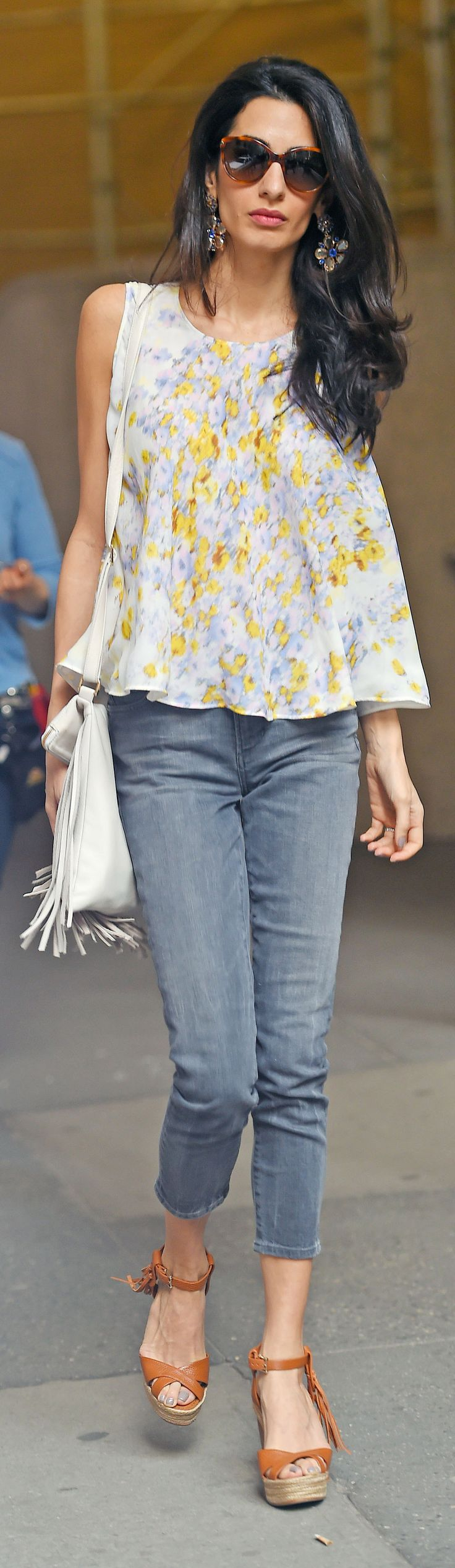 Amal Clooney wearing a Giambattista Valli top, Valentino wedges, and Dolce & Gabbana earrings on the streets of NYC.