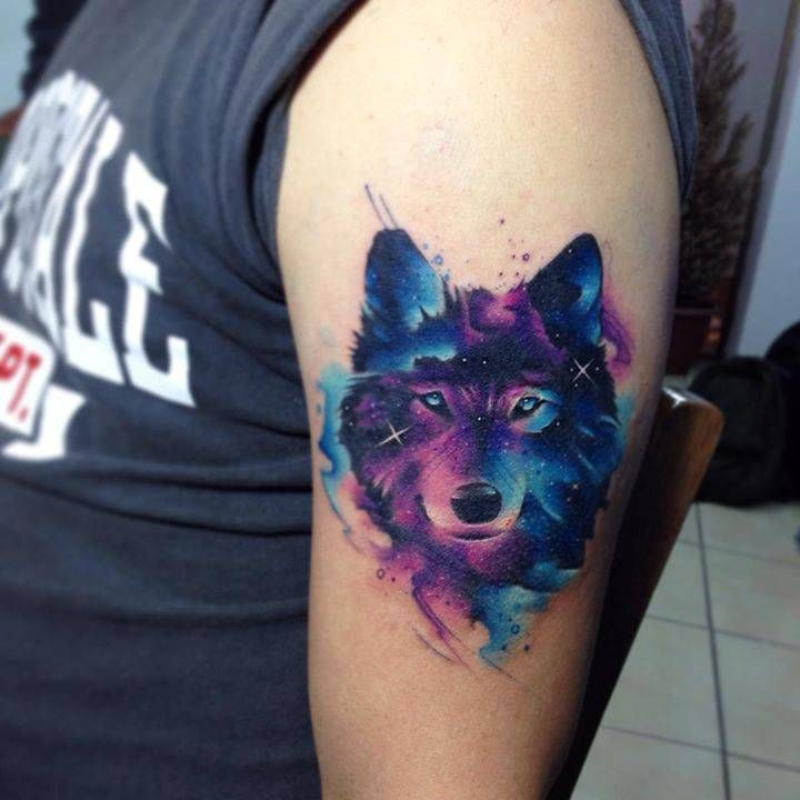 Galactic wolf tattoo on the left upper arm.