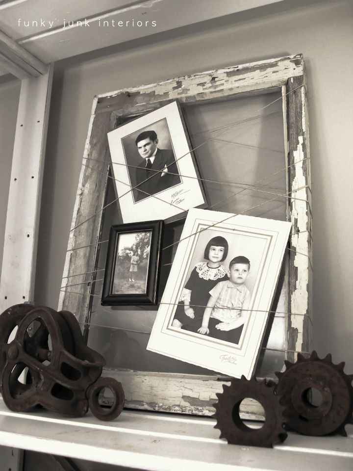 Old window with string for picture frame via Funky Junk Interiors  This old window tells a story of my family. Photos are held in tact with string for a rustic/modern twist. It's fun and trendy in an edgy kinda way.