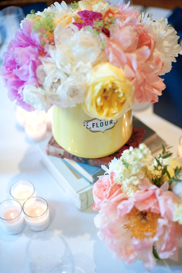 "Love the ""flour"" canister;) flowers in a flour canister, on top of vintage books #easter #flowers #pastel"