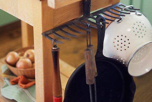 Add a little country charm by using an old rake as a rack for pots, pans, tools, wine glasses, and more!