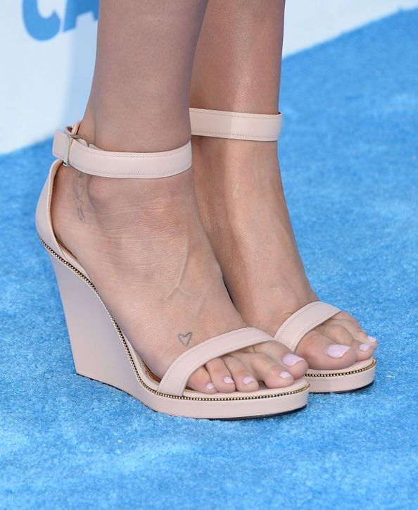 Summer Nail Polish Color: Baby Pink The pastel shade may be too girly for some, but it's all in how you wear it. Swap Kesha's nude wedges for strappy black sandals and the look is anything but saccharine. Try MAC Confectionary or Sally Hansen Sweet Talker.