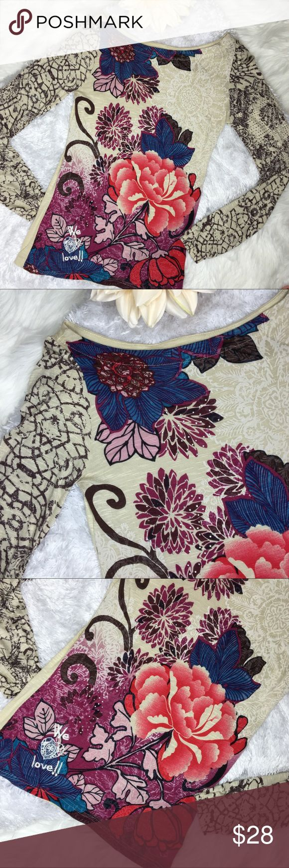 """Desigual Burnout Long Sleeve floral embellish top Desigual long sleeve floral embellish burnout top. Size Small. Made in India. 100% viscose. EUC. Like new. No damage. Wide boat neck, multi color floral """"we love"""", elastic wrist cuffs. Approx measurements laying flat: 16"""" chest 26"""" length 26.5"""" sleeve. Wear to music festival outdoors, with bralette under, with Cami and jeans. #desigual #top #shirt #longsleeve #floral #embelish #small #cream #burnout ❌no trades❌ Desigual Tops Tees - Long…"""