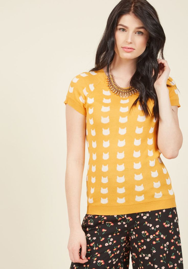 <p>Just as you felt the tides of style change, this bright yellow sweater came along and put everything in its right place! Filled with fun features like raglan short sleeves, a scalloped neckline, and white cat silhouettes all over, this ModCloth-exclusive pullover has officially brought the boldness!</p>