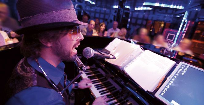 Sidle up to the piano bar have a drink and listen to the piano man on a Carnival Cruise.