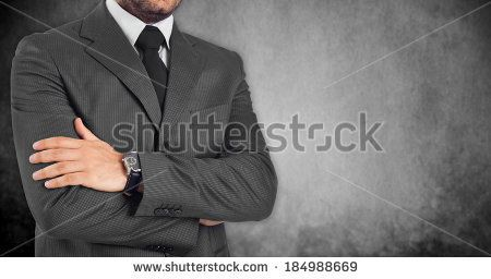 loseup of businessman with folded arms on white background.