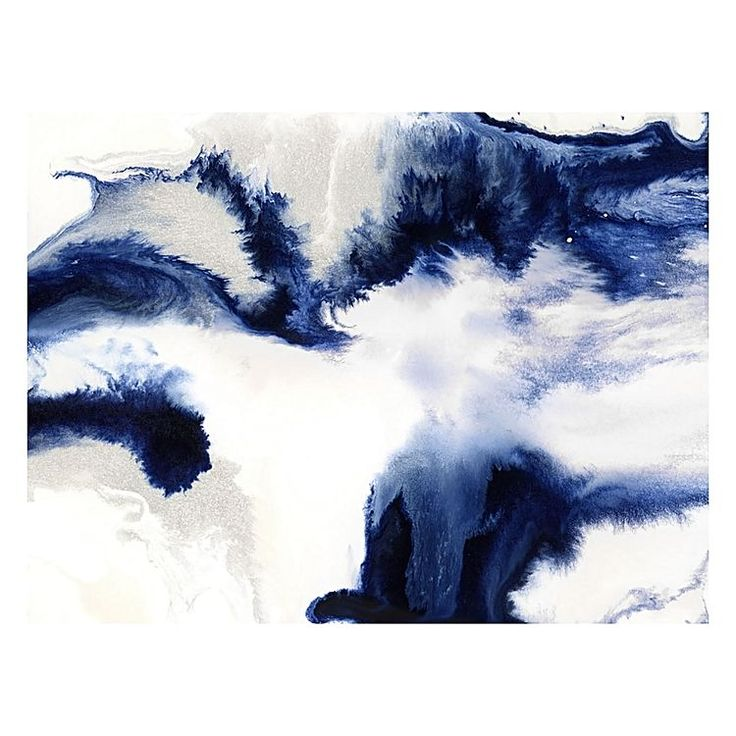Let the navy blues marbled across the Seafoam Canvas Print from Urban Road echo with modernism in your home.