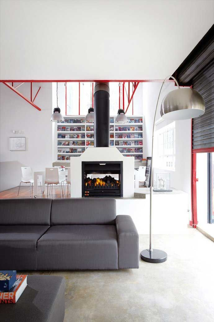 During The Day Loft Is Flooded With Natural Light And A Double Sided Fireplace Keeps It Warm Comfortable In Winter