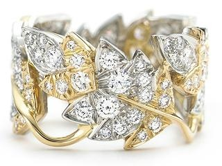 Jean Schlumberger  Four Leaves ring in 18k gold with round brilliant diamonds in platinum.