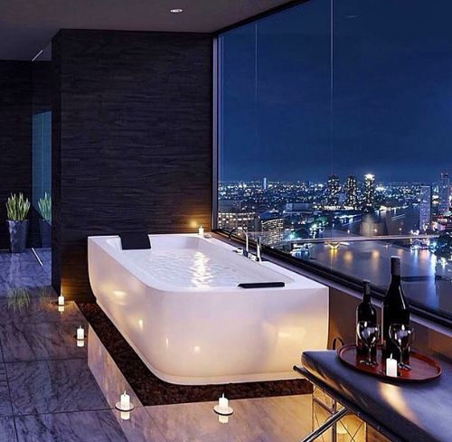Now this is how you do it. Bath tub overlooking the city.