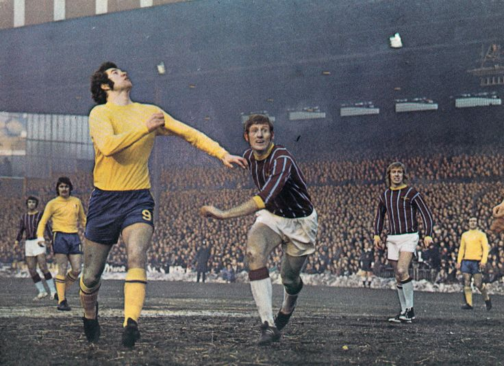 2nd January 1971. Chelsea number nine Peter Osgood and Crystal Palace centre half John McCormack try to judge the bounce on a frozen Selhurst Park pitch, in an FA Cup 3rd Round tie.