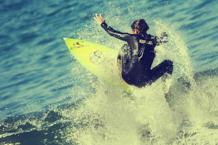 Catching a wave in Victoria Bay, Western Cape, South Africa.