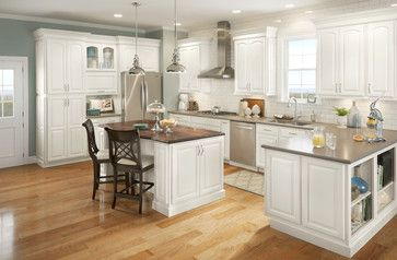 think about glass doors above the vent hood and add a door decor to the ends of the island and cabinet where the recycle bin is as well as a couple of faux legs on the island.