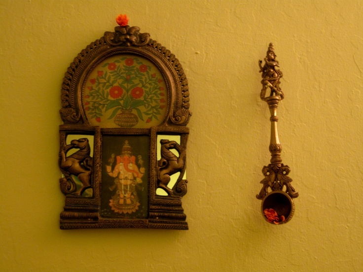Wall Hangings adorned with flowers bring that festive look be it Diwali or Navratri!