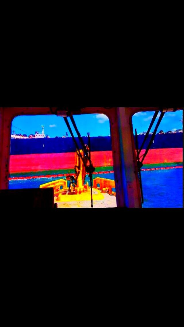 Looking out tug windows .. Big ships ... Sydney Australia nsw