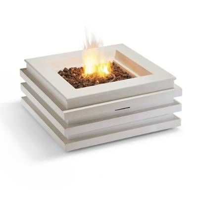 Spark conversation around a crisp white and contemporary fire table crafted    of durable Envirostone with a white finish. Flames dance from a    stainless steel ring burner with surrounded by lava rocks, inviting    intimate gatherings.                Envirostone (Link to envirostone should be included)                    Includes PVC-lined drawstring cover, lava rocks, and 10' connector            hose                    Requires standard 20 lb. propane tank, not included           ...