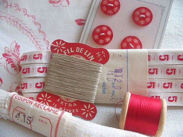 Vintage red and white sewing treasures.