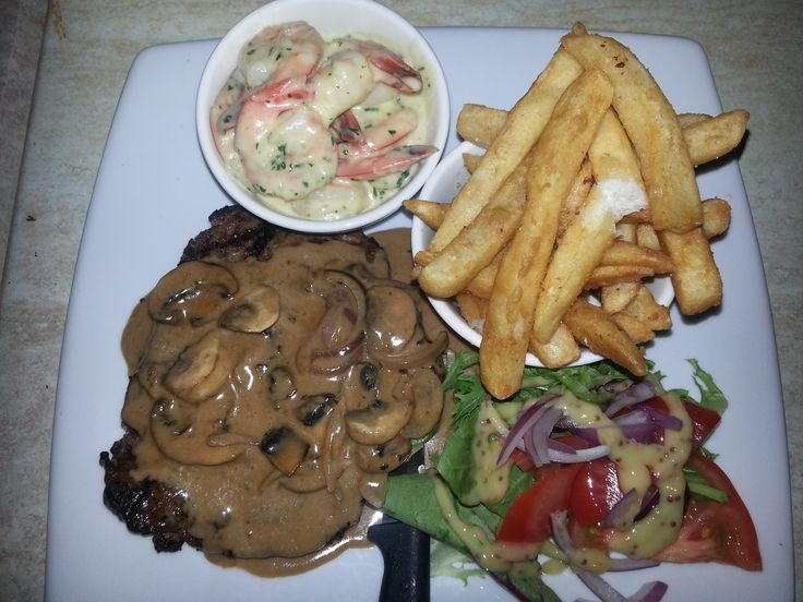 Steak and Mushroom Sauce with a side Dish of Garlic Prawns, Chips and a basic Salad with French Dressing - Went down a treat :)