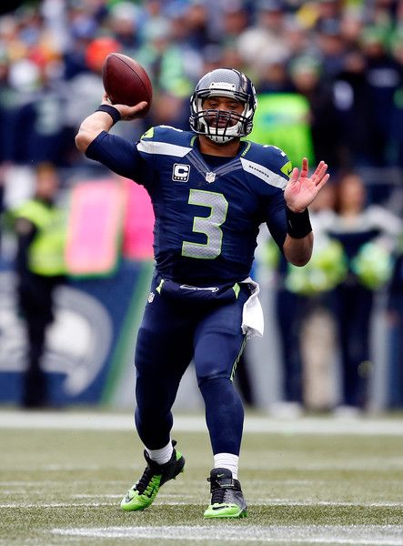 Russell Wilson Photos Photos - Russell Wilson #3 of the Seattle Seahawks passes the ball during the second half of the 2015 NFC Championship game against the Green Bay Packers at CenturyLink Field on January 18, 2015 in Seattle, Washington. - NFC Championship - Green Bay Packers v Seattle Seahawks