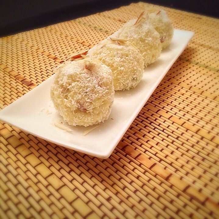 Coconut Ladoo Recipe is a rich and sweet Indian dessert which can be quickly prepared using condensed milk, desiccated coconut and cardamom powder,