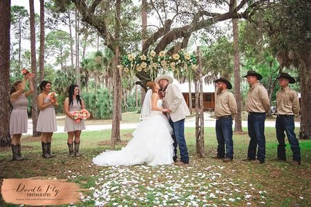 Elegant, Rustic Country Wedding Ceremony  Photographed by Doodle Fly Photography  www.DoodleFlyPhotos.com    Keywords: Bride, Bridal Portraits, Wedding Dress, Gown, Woods, Country, Elegant, Organza, SW Florida, Fort Myers, Cape Coral, Naples, Sanibel, Captiva, Estero, Doodle Fly Photography, Wedding Photography, Groom, Wedding Party, Bridal Party,