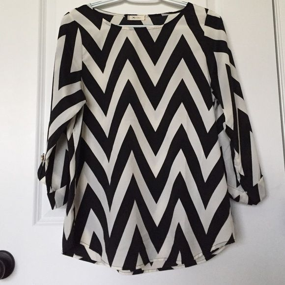 Everly Black and White Chevron Blouse Soft and feminine Everly chevron blouse. Easily dressed up for work or pair with a pair of skinnies. Excellent condition. Everly Tops Blouses