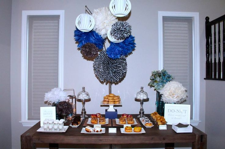 Masculine Birthday Dessert table.Dessert table with a masculine twist. This is the perfect dessert table for the man in your life. Donuts are so versatile and were the perfect choice to celebrate this birthday. Don't forget to take a shot!
