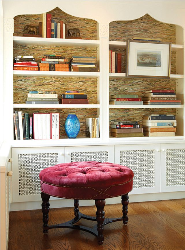 Marbleized paper on the back of the shelves with decorative detail on top. Screen doors below to hide clutter.