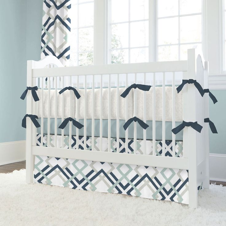 Navy and Gray Geometric Crib Bedding | Carousel Designs.  Modern yet playful, our Navy and Gray Geometric crib bedding collection will brighten your day. Perfect for your little man. The classic navy blue is accented with silver gray and robin egg blue. This handsome collection is so easy to decorate around as it offers such versatility.