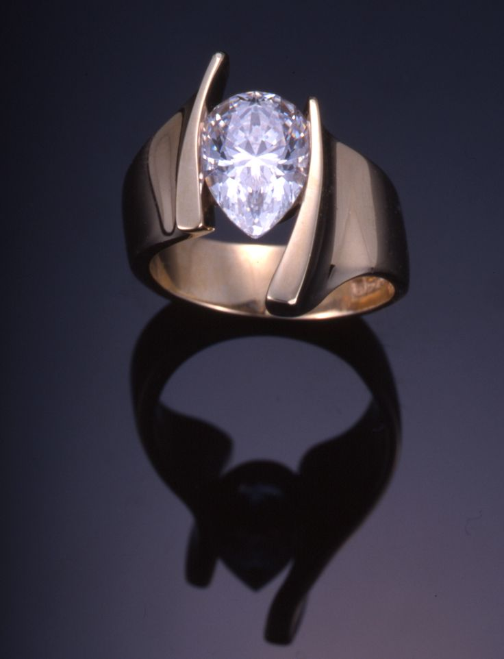 18KT yellow gold modern solitaire engagement ring, set with a 2.00ct pear shape diamond. ©2013 Thomas Michaels Designers, Inc.
