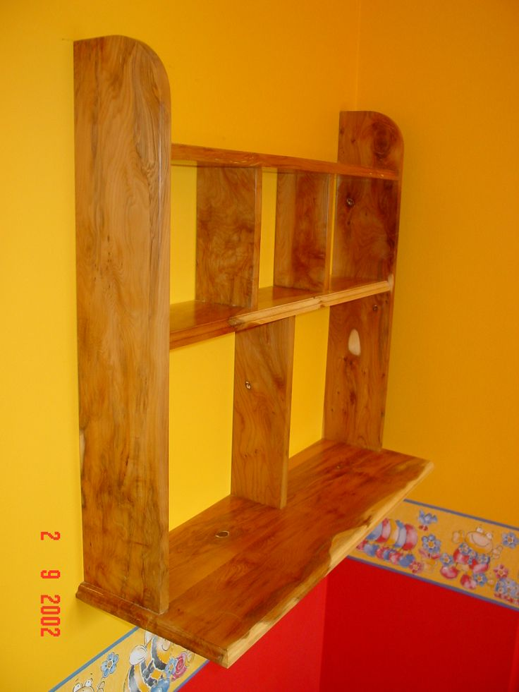 A wall bookshelf I made many years ago out of Yew