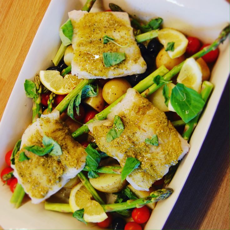 Roasted pesto cod with asparagus, olives and tomatoes