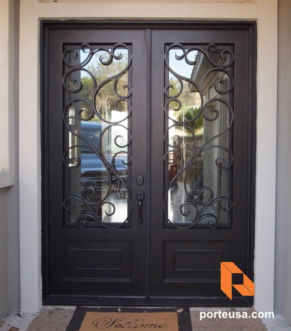 hwrought iron double door by porte color dark bronze and clear glass