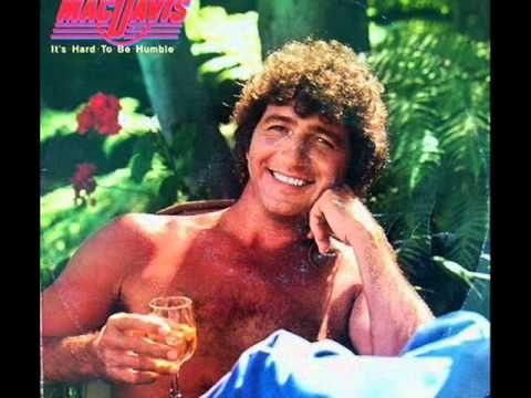 Mac Davis - It's Hard To Be Humble (1980).  I love this song.  This brings back so many memories.