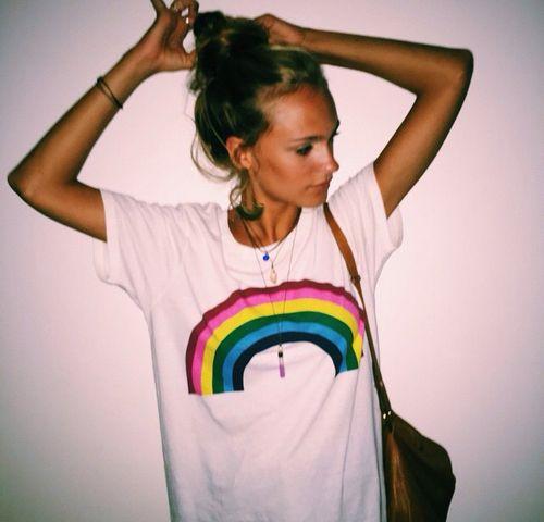 graphic tee // rainbow on a white tee // leather purse // messy bun //