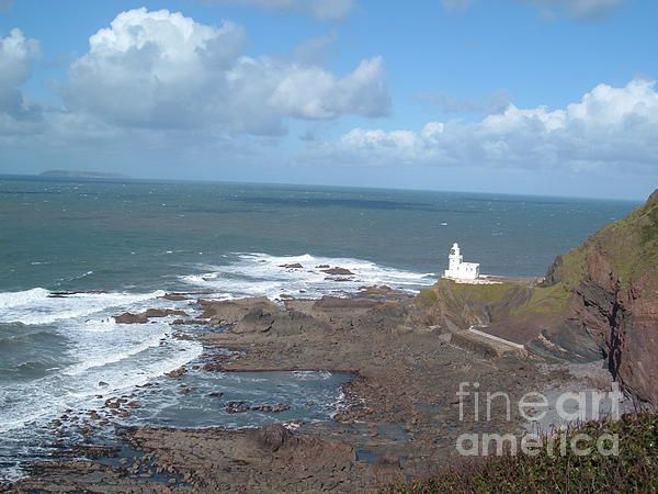 The remote Hartland Point Lighthouse on the treacherous north Devon coast guides shipping safely from the open Atlantic into the Bristol Channel. Lundy Island (Norse for puffin) can be seen on the horizon and is a popular tourist destination and marine conservation area. A short drive from where I live this was taken on the fantastic South West Way coastal path. Photo by & copyright Richard Brookes