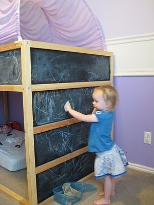 Ikea Kura bed hack - paint the ugly blue panels with chalkboard paint and kids can draw all over their bed! Ooo do I love this idea. Plus the bed is awesome too because it's like a mini bunk bed, awesome play space upstairs
